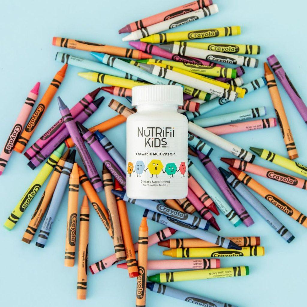 nutrifii kids multivitamin jar on crayons